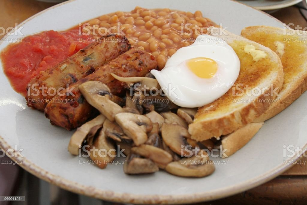 traditional english cooked breakfast with vegetarian sausages stock photo