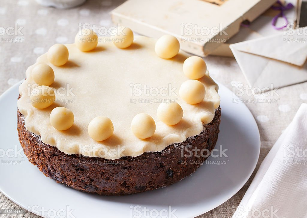 Traditional English Easter cake with marzipan decoration on white plate. stock photo
