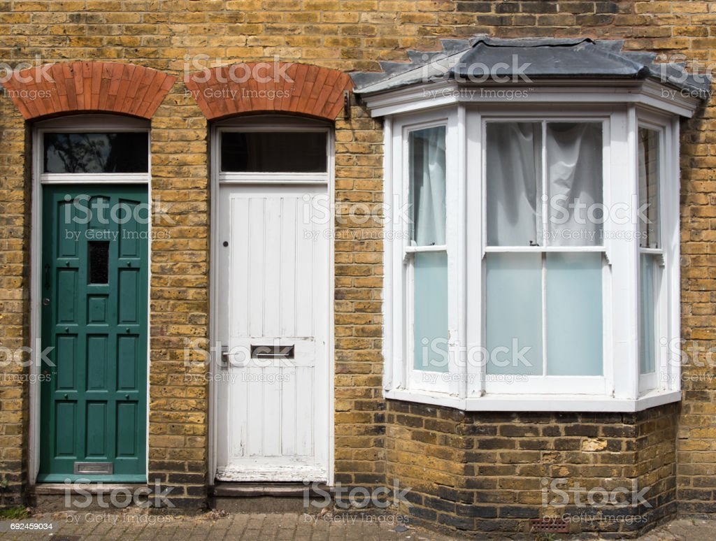 Traditional English house yellow door entrance stock photo