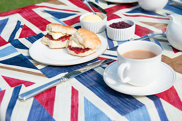 traditional english tea on patriotic tablecloth - scone bildbanksfoton och bilder