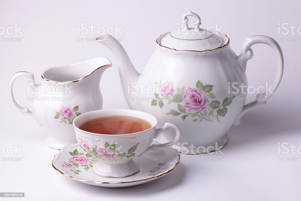 Traditional english tea with white tea set floral dishware stock photo