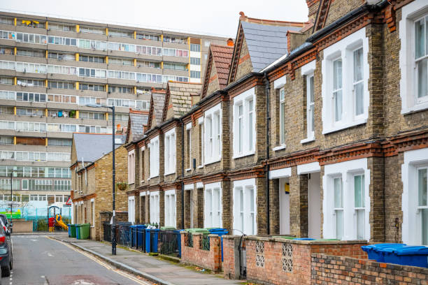 Traditional English terraced houses with huge council block in the background stock photo