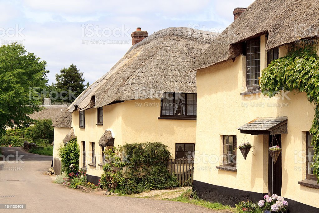 Traditional English village thatched cottages stock photo