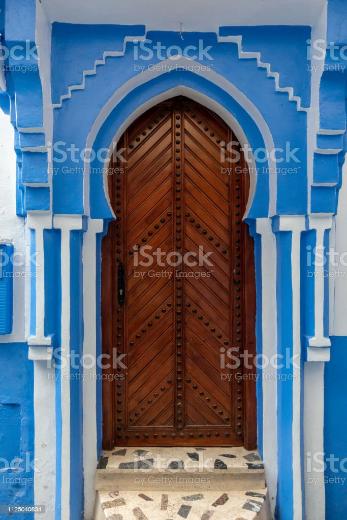 A traditional entrance door in the blue streets of Chefchaouen, Morocco stock photo