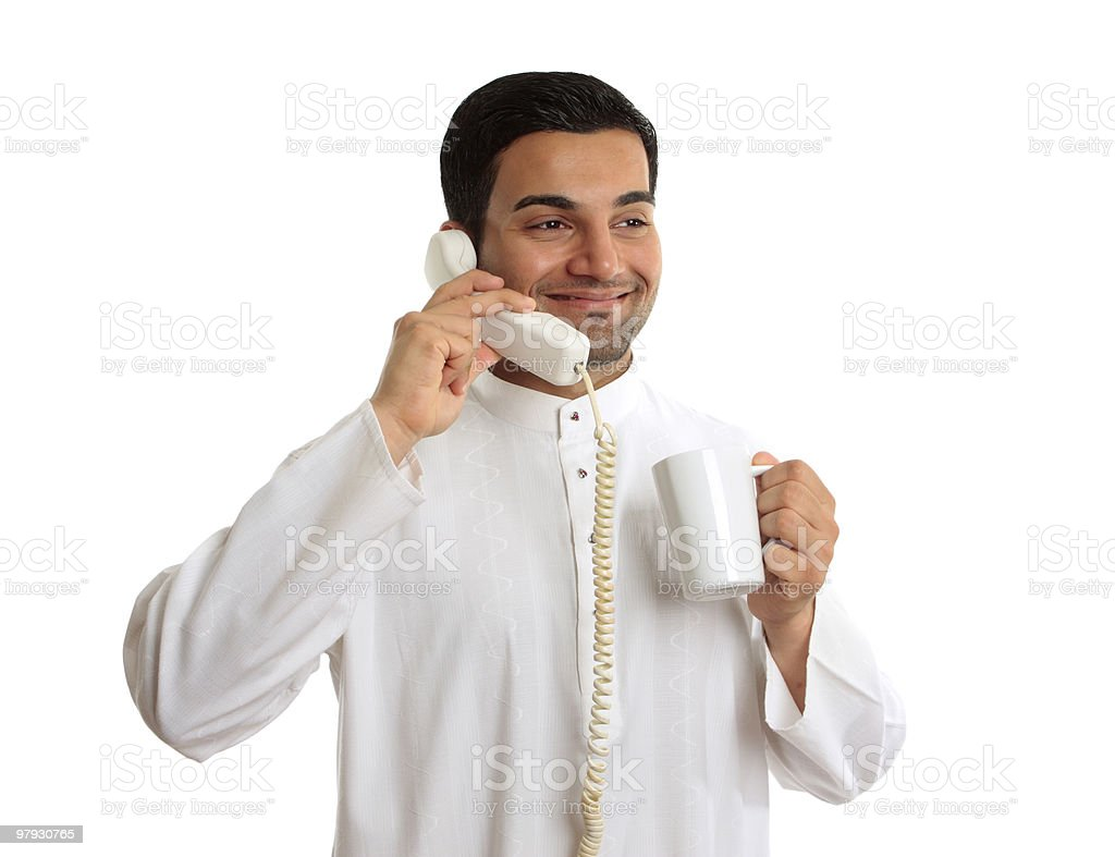 Traditional ethnic business man talking on telephone royalty-free stock photo