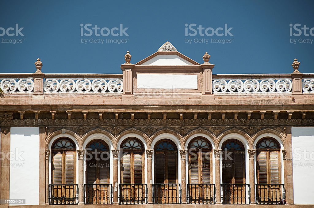Traditional European Architecture showing Archways and shuttered doors royalty-free stock photo
