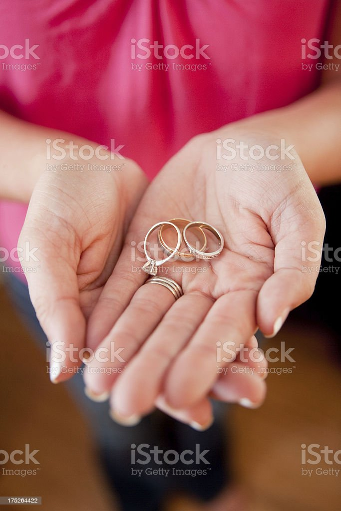 Traditional Exchange Wedding Rings In Palm Of Brides Hand Stock