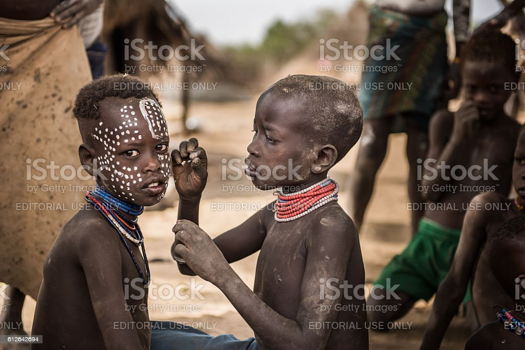 Traditional facial painting in the Karo Tribe stock photo