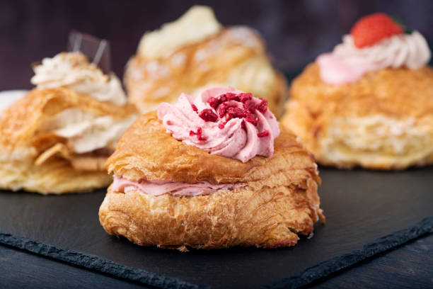 traditional fastelavn cakes or danish cream cakes - fastelavn stock pictures, royalty-free photos & images