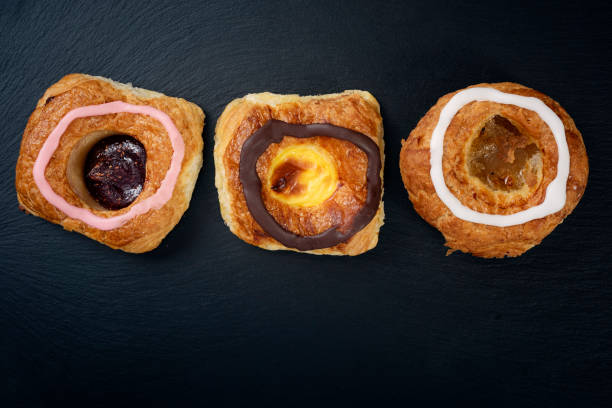 traditional fastelavn cakes or danish pastries - fastelavn stock pictures, royalty-free photos & images