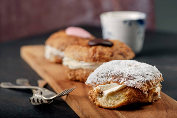 traditional fastelavnboller or danish cream cakes - fastelavn stock pictures, royalty-free photos & images