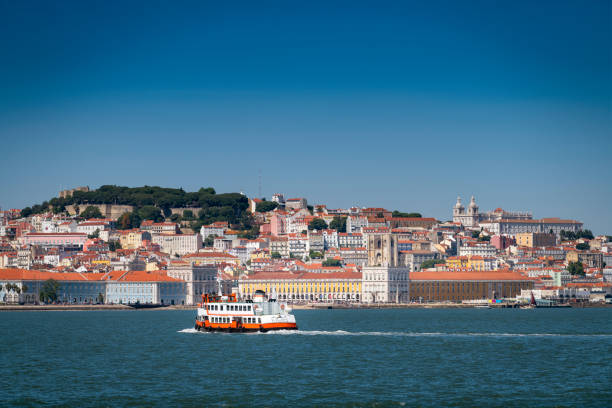 A traditional ferry boat (Cacilheiro) crossing the Tagus River in Lisbon. stock photo