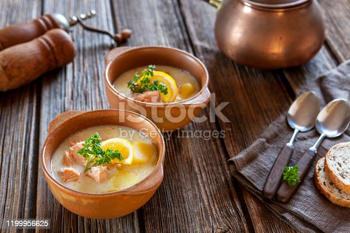 Traditional Finnish salmon soup  Lohikeitto with potato, creme and lemon
