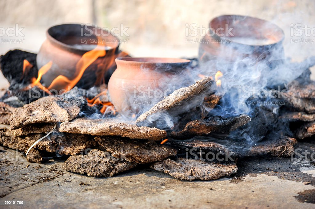 Traditional fire-coocking, Varanasi, India stock photo