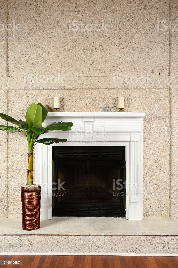 Traditional Fireplace on a Tabby Seashell Wall stock photo