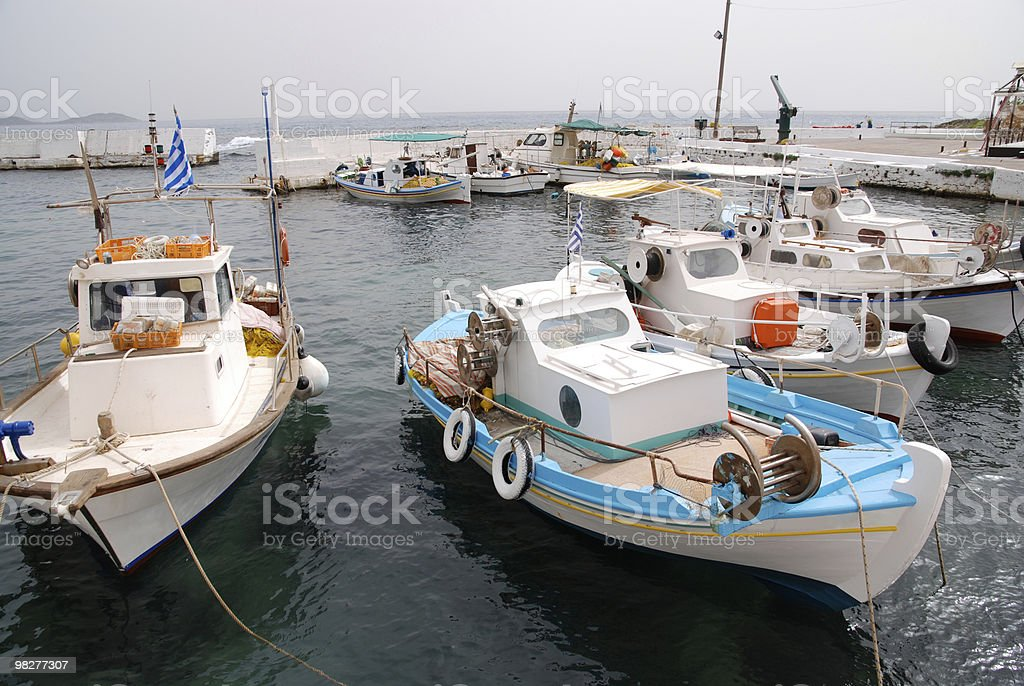 traditional fisherboats in a greek port royalty-free stock photo