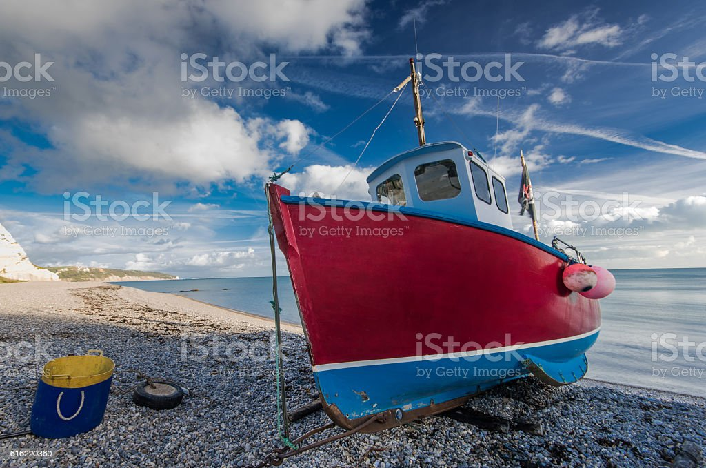 Traditional fisherman boat on beach in Beer, Devon,UK stock photo