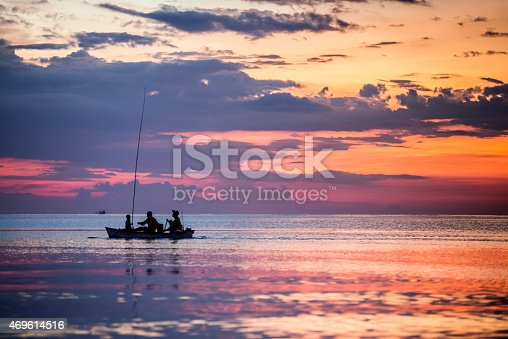 istock Traditional fishing boat at sunset in Lovina beach in Bali 469614516