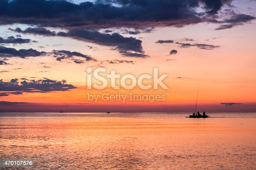 istock Traditional fishing boat at sunset in Lovina beach in Bali 470107576