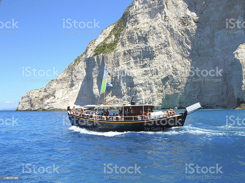 Traditional fishing boat full of tourists in shipwreck beach royalty-free stock photo