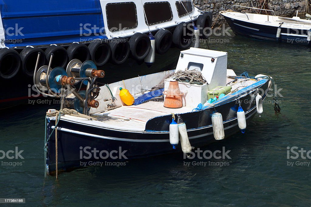 Traditional fishing boat in Greece stock photo