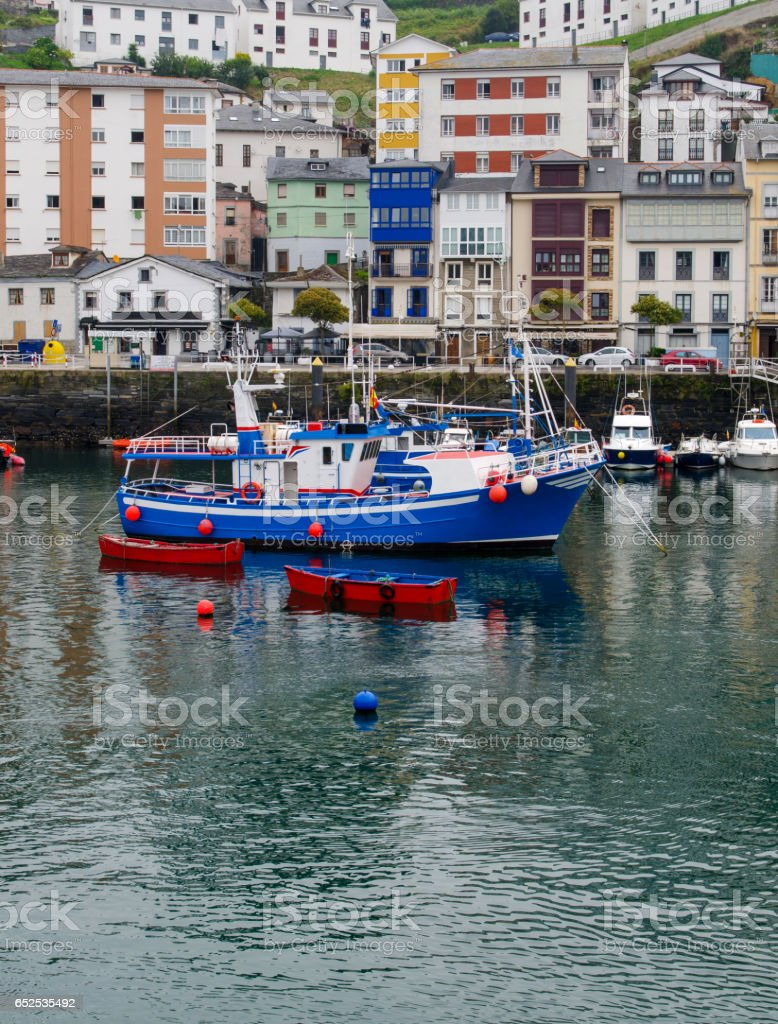Traditional fishing boat moored in luarca stock photo