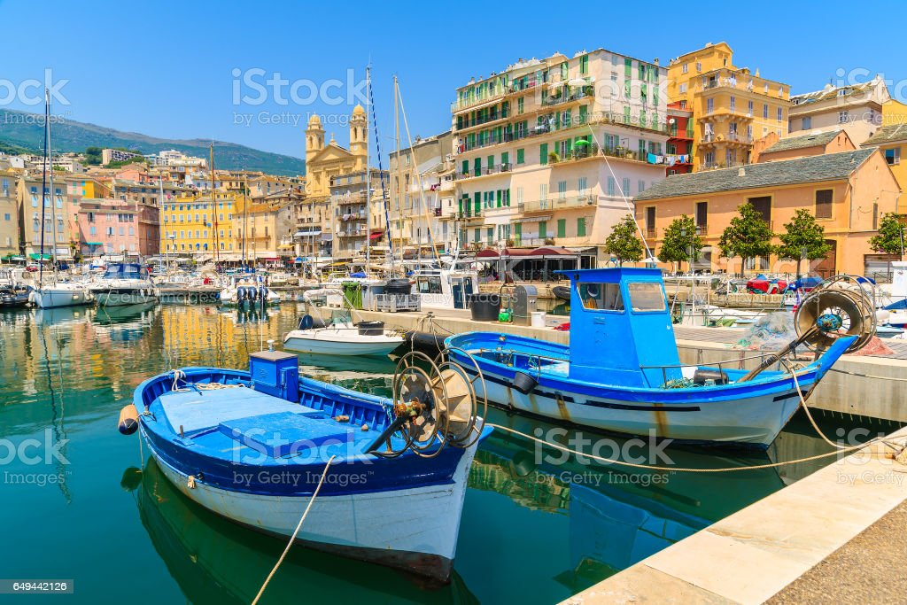 Traditional fishing boats in Bastia port on sunny summer day, Corsica island, France stock photo