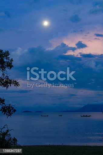 Traditional Fishing Boats on an African Lake with dramatic sky Mbita towards Rusinga Island Lake Victoria Nyanza Province Kenya East Africa