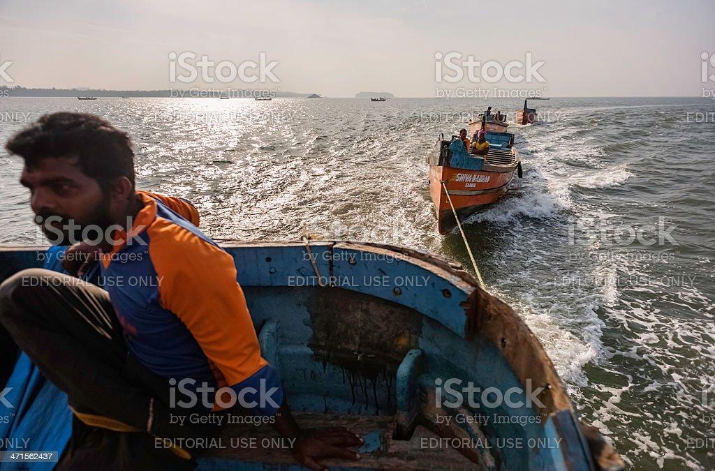 Traditional fishing boats set out to sea, Kerala, India. royalty-free stock photo