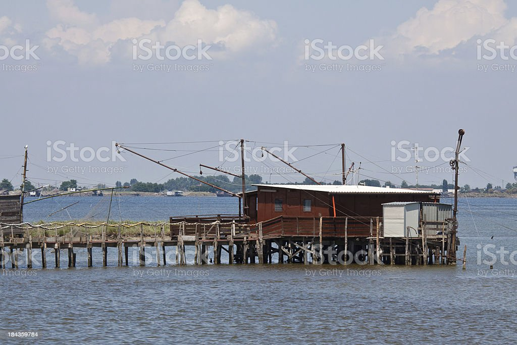 Traditional fishing house at Comacchio Valley stock photo
