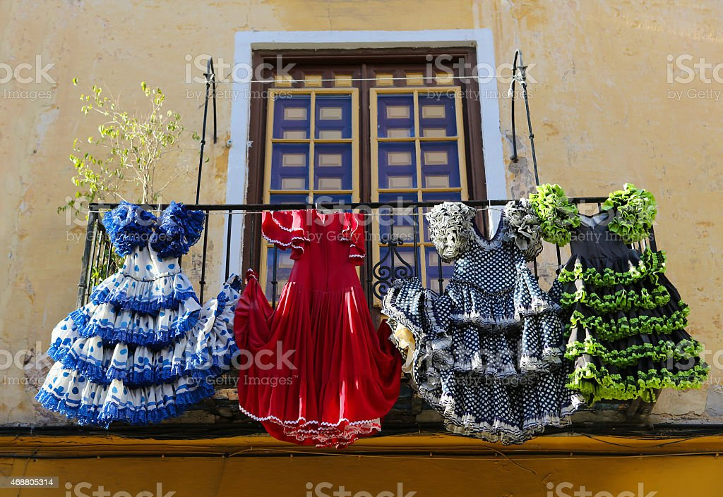 Traditional flamenco dresses at a house in Malaga, Andalusia, Sp stock photo