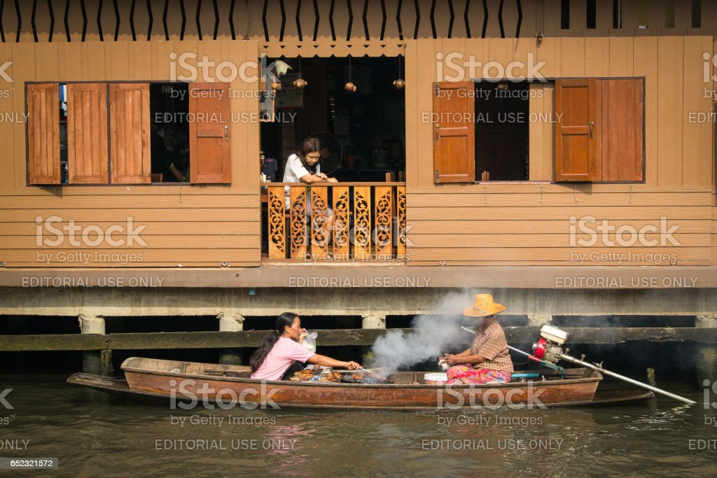 BANGKOK, THAILAND - Febuary 2 :Traditional floating market at Klong Bang Luang on Febuary 2, 2013 in Bangkok, Thailand stock photo