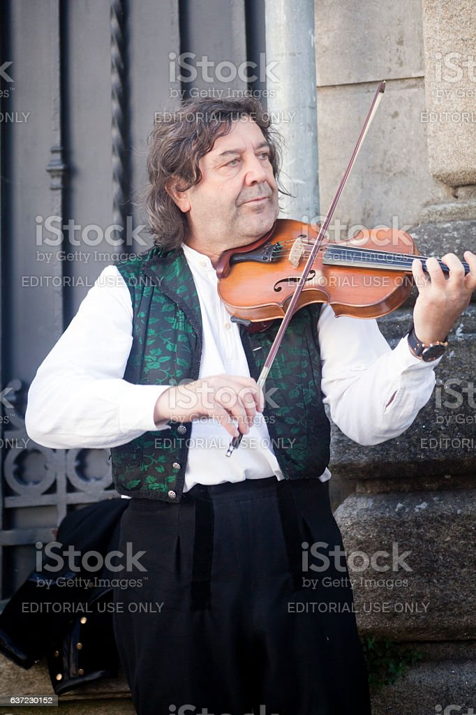 Traditional folk musician playing violin. stock photo