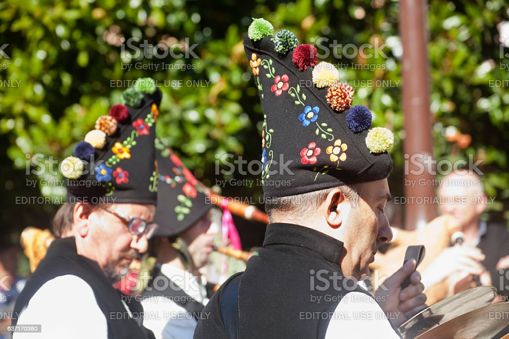 Traditional folk musicians wearing multuicolored embroidered hats stock photo