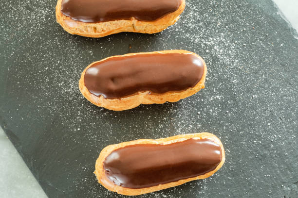 Traditional french pastry : aerial view of Eclair with chocolate icing stock photo