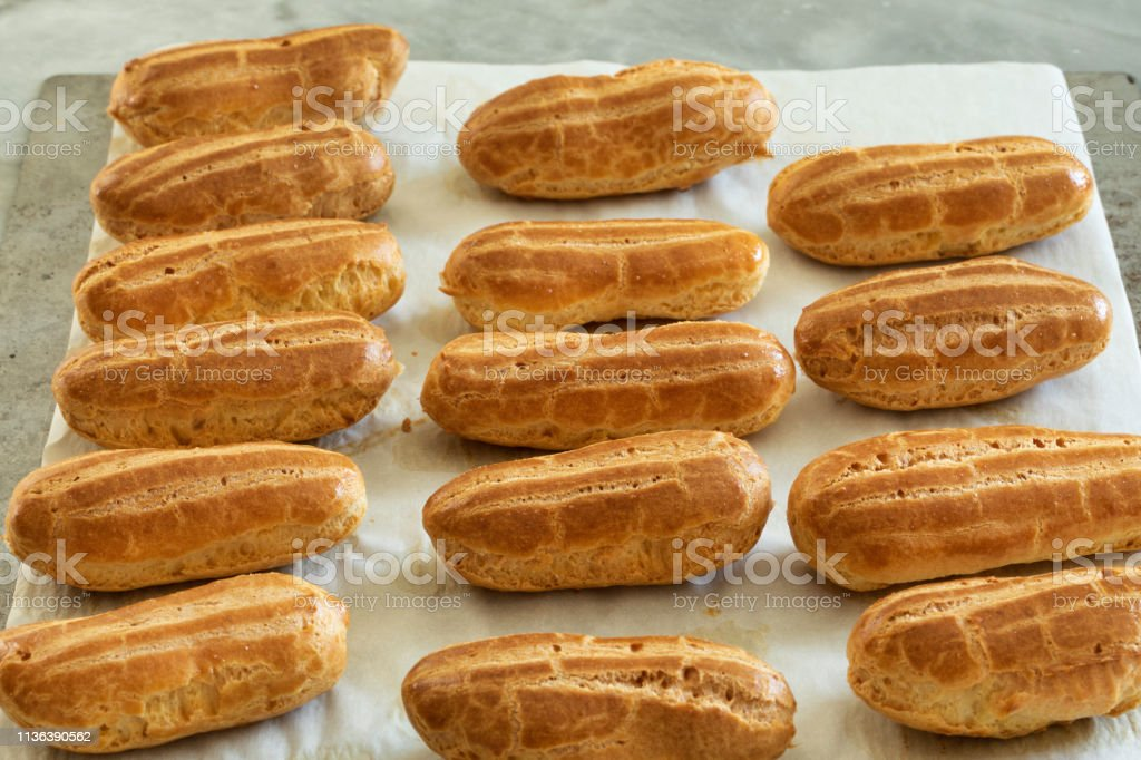 Traditional french pastry : choux pastry on a baking sheet stock photo