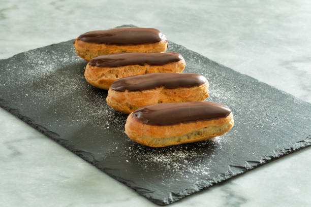 Traditional french pastry : Eclair with chocolate icing stock photo