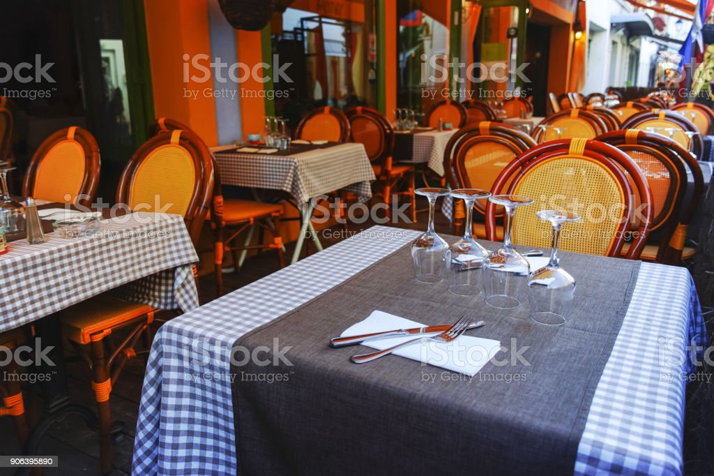 Traditional French street cafe in Provence, settled for lunch or dinner with wine, nobody stock photo