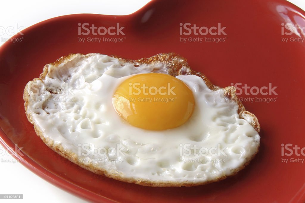 traditional fried egg on  heart shape plate royalty-free stock photo