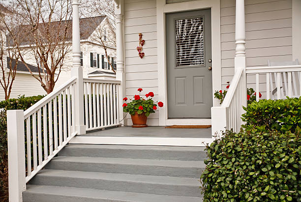 traditional front porch with geraniums - front view stock photos and pictures