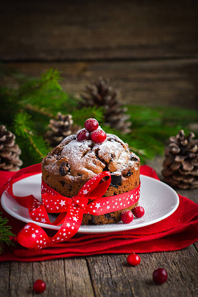 Traditional fruitcake for Christmas decorated with powdered suga stock photo