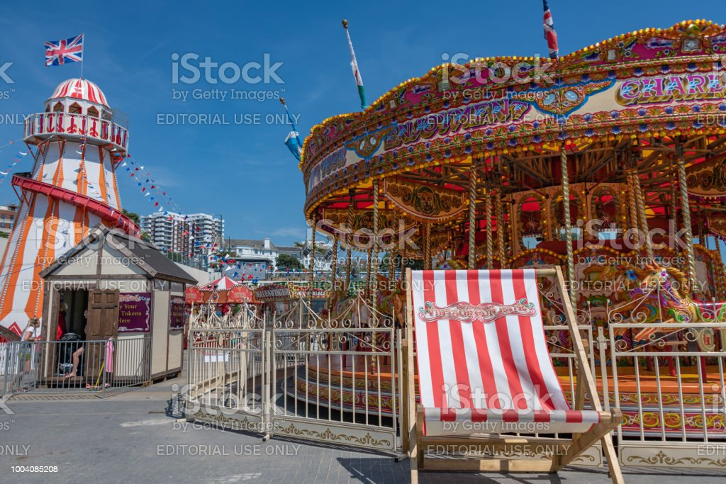 Traditional fun fair rides at the seafront in Bournemouth, UK stock photo
