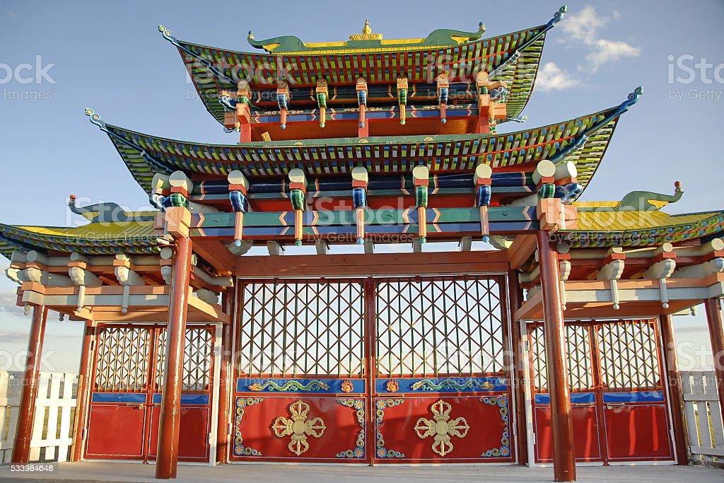 Traditional gate in the Ivolginsky Datsan, Buryatia, Russia. stock photo