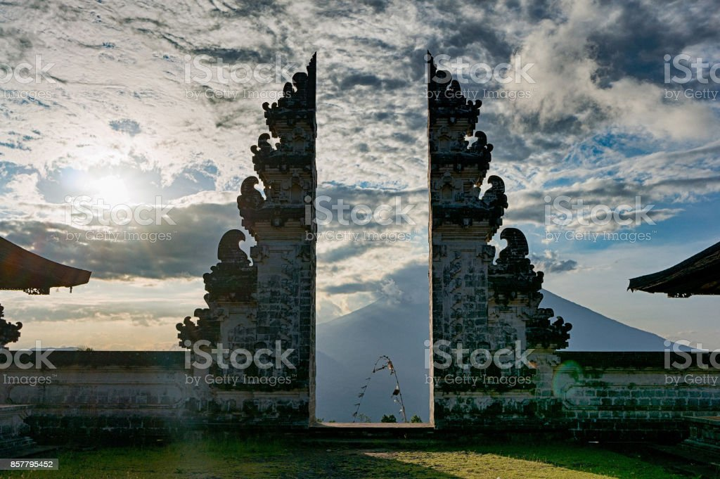 Traditional gateway into a balinese temple Pura Luhur Lempuyang Split gateway wich is called candi bentar in the acient balinese temple Pura Luhur Lempuyang, with stratovolcano Gunung Agung on the background, Bali, Indonesia Ancient Stock Photo