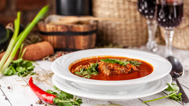 Traditional Georgian and Armenian cuisine. Tomato soup with rice Harcho of lamb, with walnut, garlic and cilantro. Copy space, selective focus