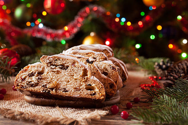 traditional german christmas cake stollen with marzipan, nuts and berries - marzipanbrot stock-fotos und bilder