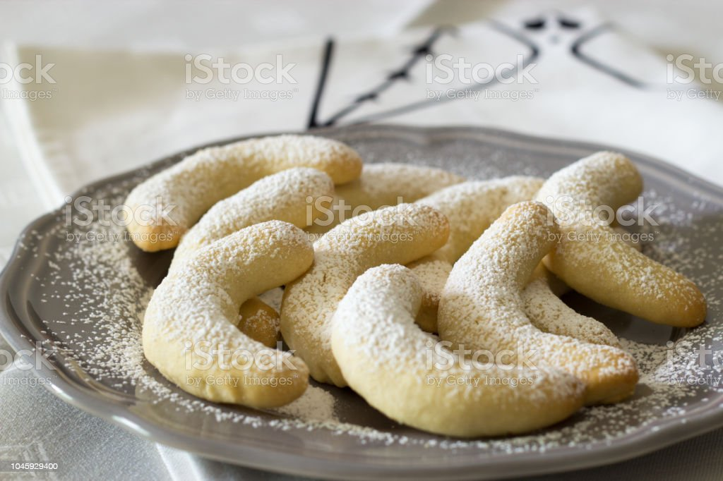 Traditional German Christmas Cookies Vanilla Crescent Vanillakipferl With Icing Powder On Gray Plate Close Up Selective Focus White Background Stock