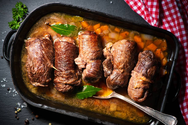 Traditional german meal of beef roulades in roast pot stock photo