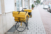 Traditional German yellow bike for mail delivery.