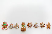 Traditional gingerbread on a white surface in a minimal style. Christmas concept. Upstairs is a place for text.